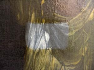 Nettoyage d'un tableau, la zone centrale plus claire est la partie dévernie